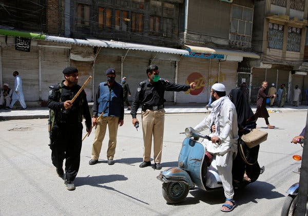 Police officers enforced shutdown restrictions in Peshawar, Pakistan, on Tuesday.