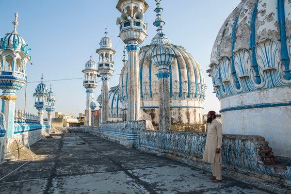 Muhammad Kazim, caretaker of the main mosque in Rawalpindi, Pakistan, on its roof on Thursday.