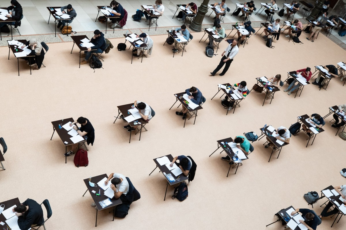 Students take their exams while socially distancing at a university in Belgium on Tuesday. Photo: DPA