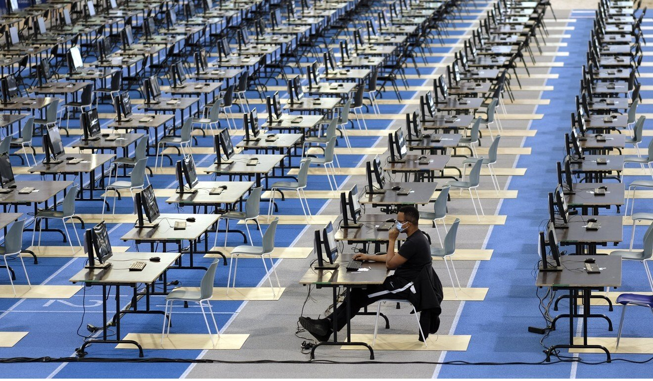 A single student takes an exam at a university in Belgium on Tuesday after his classmates opted to do theirs from home. Photo: DPA